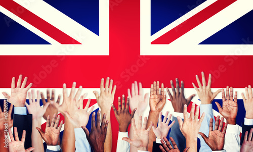 Multi-Ethnic Arms Raised and a Flag of United Kingdom