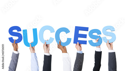 Business People Holding the Word Success