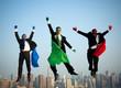 Multi-ethnic Superhero Businessmen Jumping