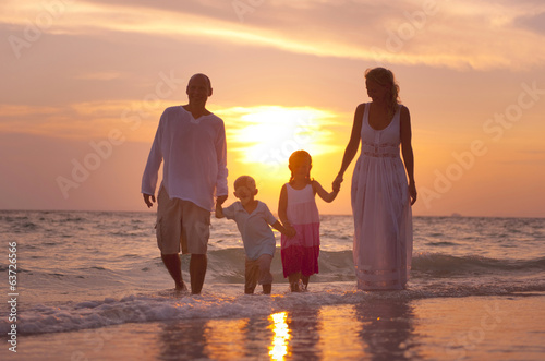 Family having fun on vacation with perfect sunset