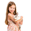 cute smiling girl with a baby rabbit