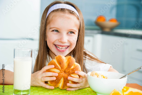 little girl eating her breakfast