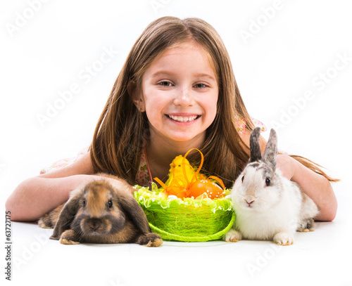 little girl with her  two rabbits