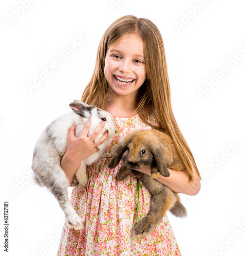 cute smiling girl with two baby rabbits