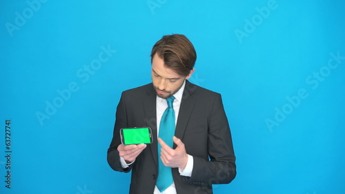 businessman with his smartphone showing the app