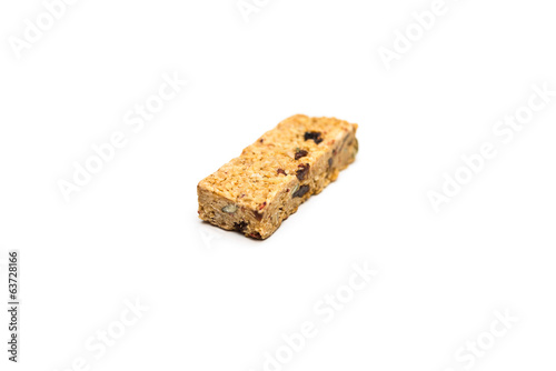 Healthy oatmeal energy bar isolated on white.