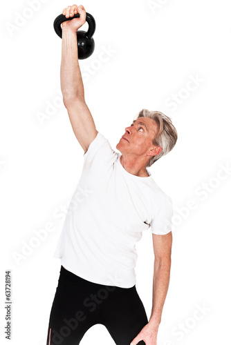Senior fitness man exercising with weight. Isolated on white.