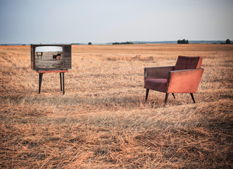 TV and chair in summer field