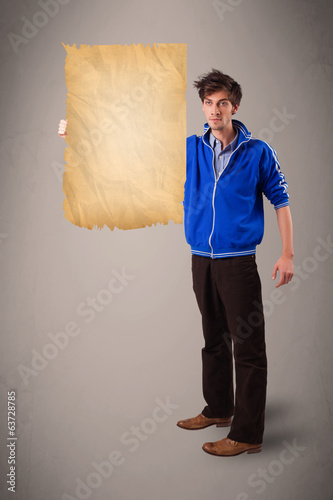 Young man presenting old paper copy space