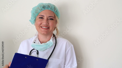 Portrait of a female doctor taking notes and smiling
