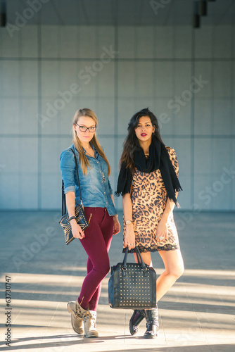 Young women portrait outdoors with modern building as background