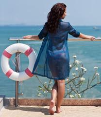 Young beautiful woman with floating equipment enjoying ocean