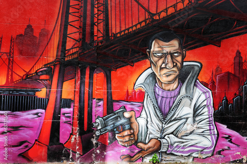 Graffiti of a gangster holding a gun