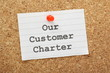 Our Customer Charter reminder on a cork notice board