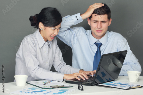 sad and depressed businessman and woman