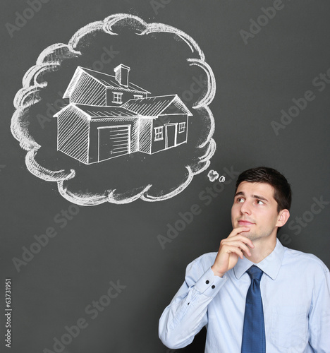 business man dreaming a house