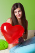 girl with a balloon in the shape of a heart