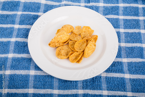 Corn Chips on White Plate and Blue Towel