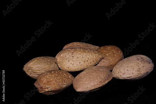 almonds isolated on a black