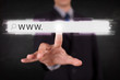 Young businessman touching web browser address bar with www sign