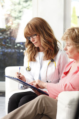 Female doctor with senior patient