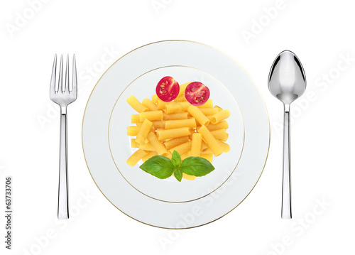 Delicious pasta with tomato and basil on plate isolated on white