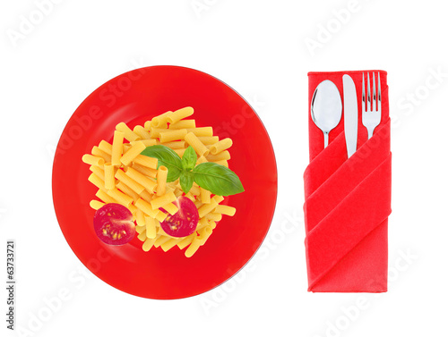Delicious pasta with tomato and basil on red plate isolated on w