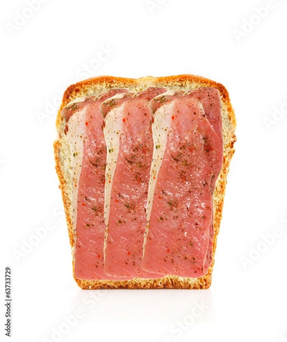 tasty bacon with spicesover bread isolated on white