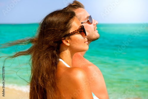 Happy Couple in Sunglasses Having Fun on the Beach. Summer