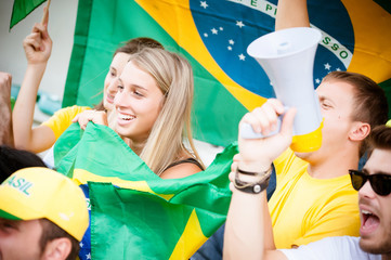 Group of brazilian supporters at stadium