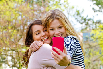 Two girls making a selfie