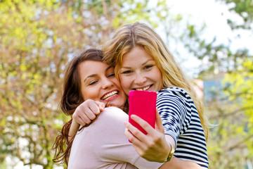 Two girls making a selfie