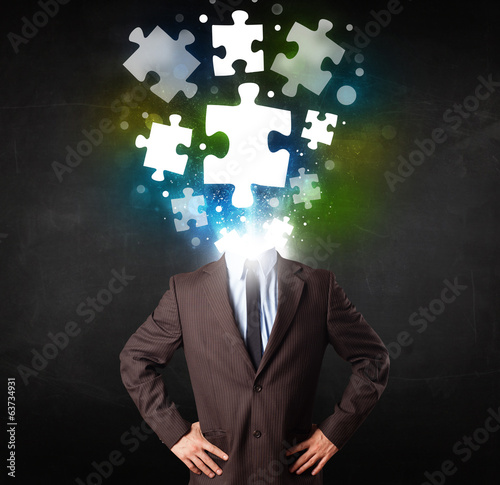 Character in suit with puzzle head concept