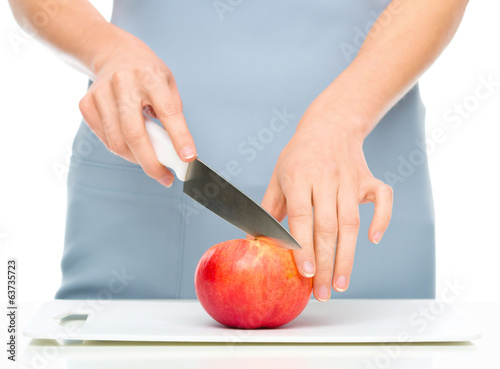 Cook is chopping apple