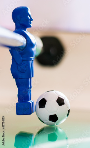 Figurine with a ball on table football