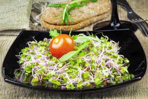 Tasty chinise rose sprouts with bread on wooden table