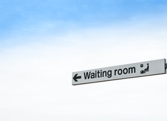 Waiting Room Sign Isolated against Sky Background
