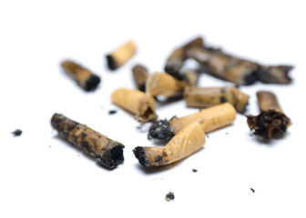 A pile of cigarette butts on the white background.