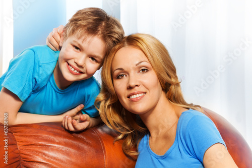 Cheerful mother and son together at home