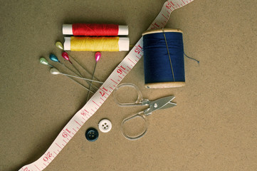 old style image of cotton reels and other sewing items