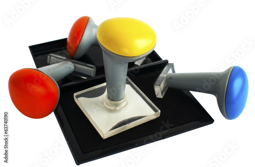 Plastic rubber stamps and inkpad isolated on white backgound