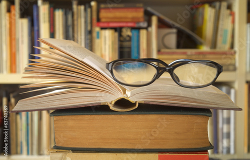 open books with spectacles, close up
