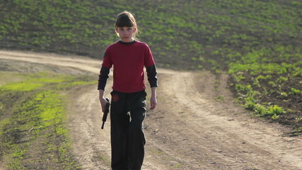 Boy with gun.Boy playing weapon.Teenager a gun aiming.