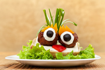 Funny meatball sandwich with vegetables