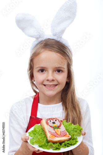Bunny chef presenting her masterpiece - a rabbit shaped sandwich