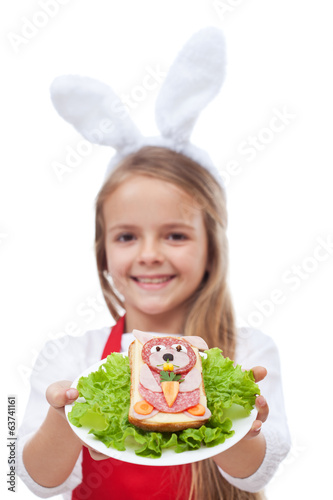 Bunny shaped sandwich presented by little girl