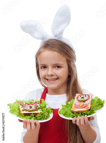 Little bunny chef with rabbit themed sandwiches