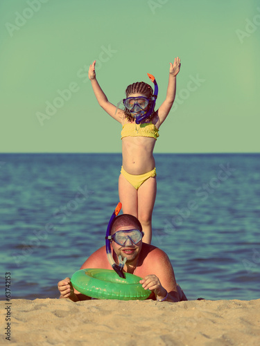 father and daughter in scuba mask - vintage retro style