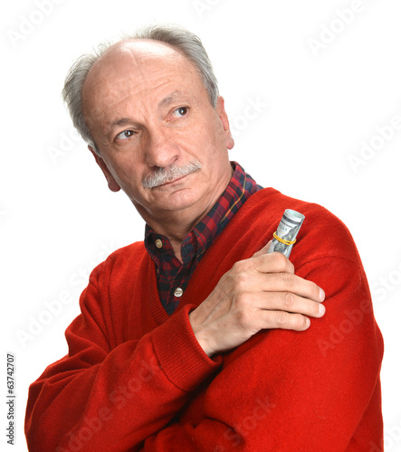 Elderly sad man with dollar bills
