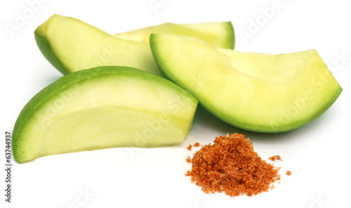 Sliced green mango with chili powder and salt